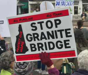 photo of a black and red stop granite bridge sign